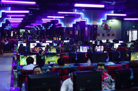 Gamers in night game club editorial photo