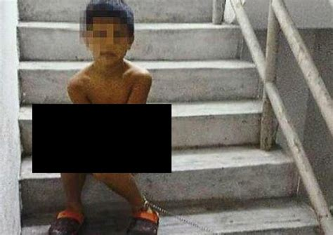 Malaysian boy stripped and chained in public for being